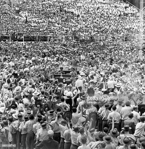 Royal Tour of Australia. The Queen and The Duke of Edinburgh drive through the crowds in a Land Rover at the Bushman's Carnival in Brisbane. 11th...