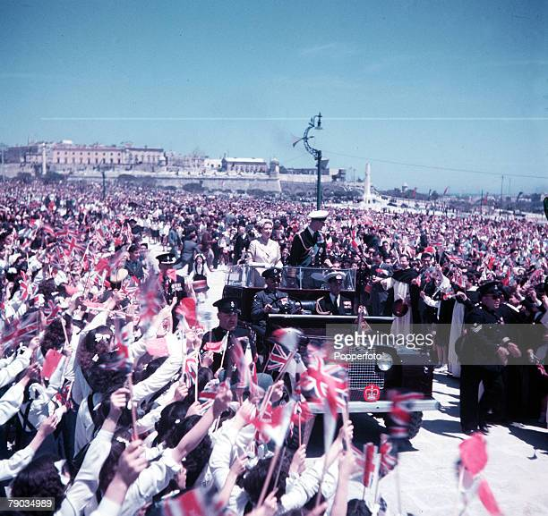 Royal Tour of Malta, Floriana Granares, May 1954, Queen Elizabeth II and the Duke of Edinburgh in a Land Rover acknowledge the cheers of Maltese...