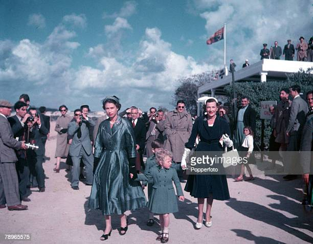 1954 Royal Tour of Malta Queen Elizabeth II is pictured with Prince Charles Princess Anne and Lady Mountbatten at the Marsa Polo ground where they...