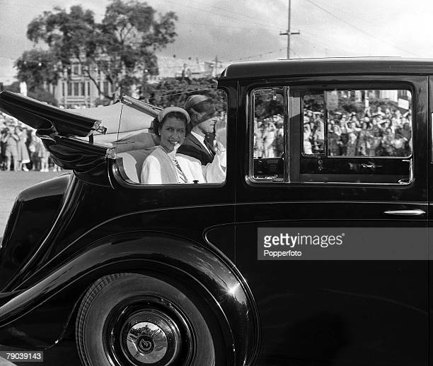 Royal Tour of New Zealand 19 January 1954 Queen Elizabeth II and the Duke of Edinburgh sit in the open back of their Tour car as they leave the Hotel...