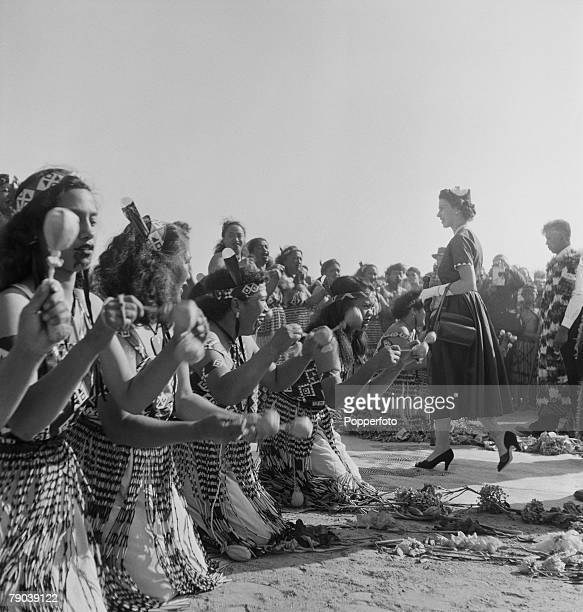 Royal Tour of New Zealand 19 January 1954 Queen Elizabeth II of the United Kingdom passes through rows of singing Maori women after leaving the...