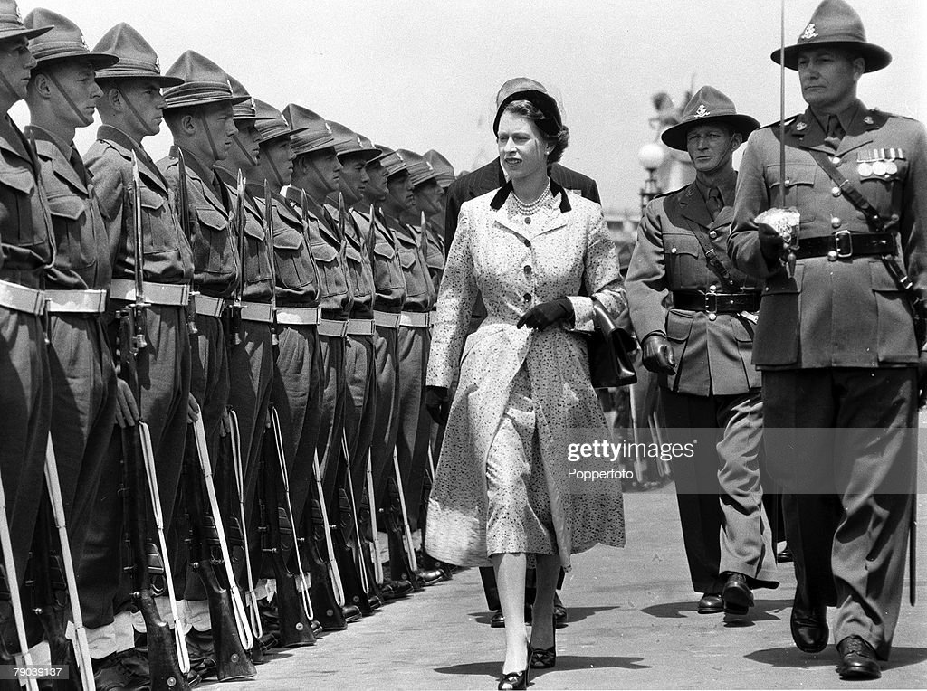 Royal Tour of New Zealand 19 January 1954: Queen Elizabeth II of the United Kingdom, accompanied by the commander of the Guard of Honour, inspecting the guard outside Parliament House. : News Photo