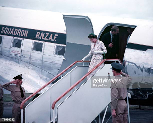 1954 Royal Tour of New Zealand Queen Elizabeth II and Prince Philip the Duke of Edinburgh are pictured getting off the aeroplane at Wellington Airport
