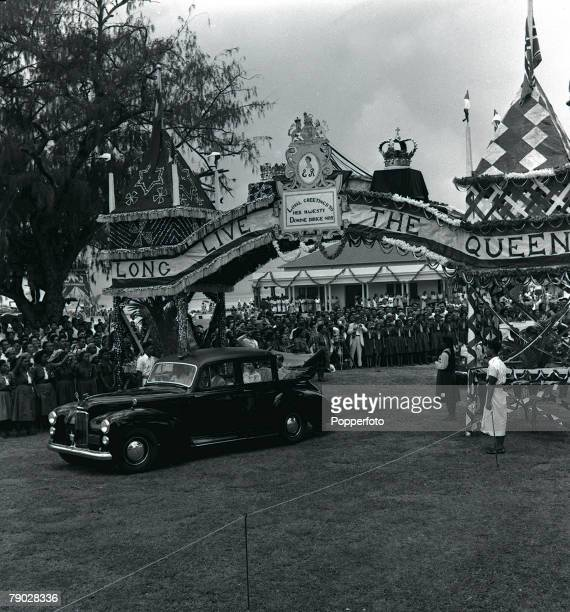 Royal Tour of Tonga December The car of Her Majesty Queen Elizabeth II enters Male through a triumphal arch made of sea shells during her visit to...