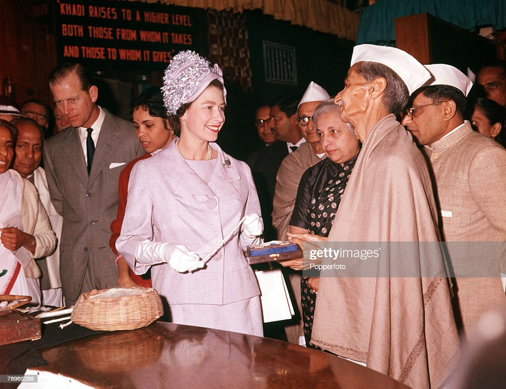 1961. Royal Tour to India. Queen Elizabeth II and Prince Philip, the Duke of Edinburgh, are pictured visiting a crafts centre in Delhi. : News Photo