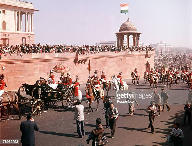 1961 Royal Tour to India Queen Elizabeth II and Prince Philip the Duke of Edinburgh are pictured riding in a carriage through the streets of Delhi...