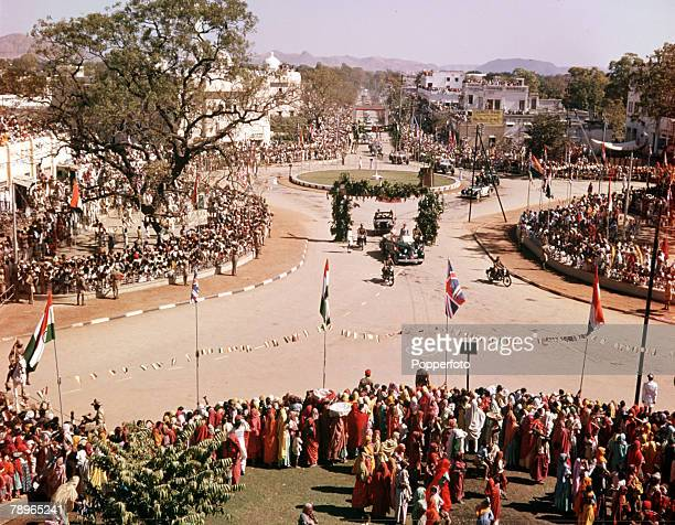 1961 Royal Tour to India Queen Elizabeth II is pictured being driven through the streets of Udaipur with the streets lined with wellwishers