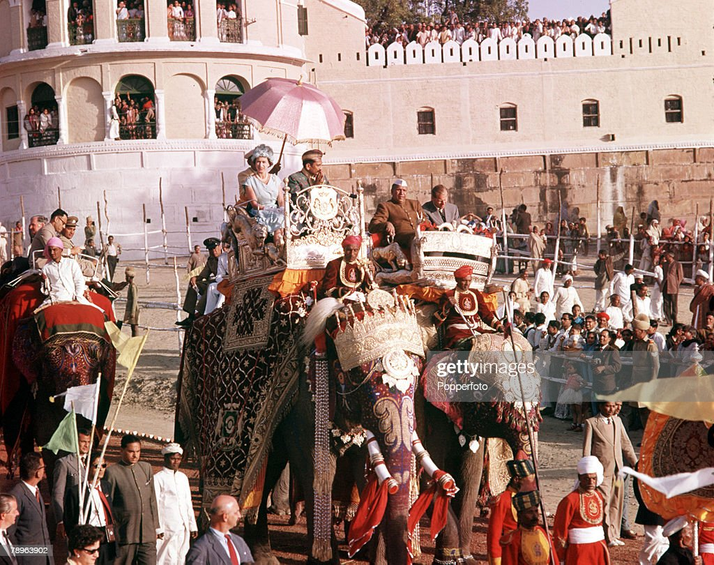 1961. Royal Tour to India. Queen Elizabeth II is pictured taking an elephant ride in the town of Banares. : News Photo