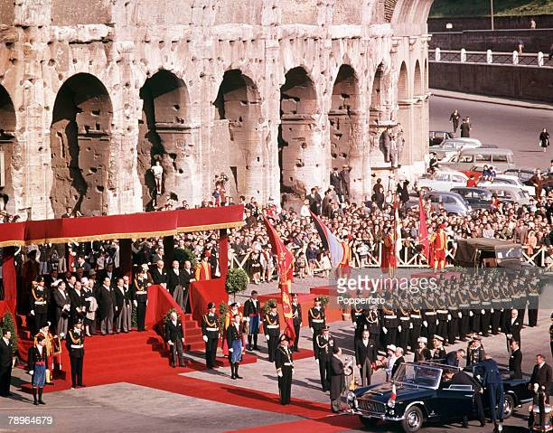 1961 Royal Tour to Italy Queen Elizabeth II is pictured arriving at the Colosseum in Rome where she is met by an official reception and hundreds of...