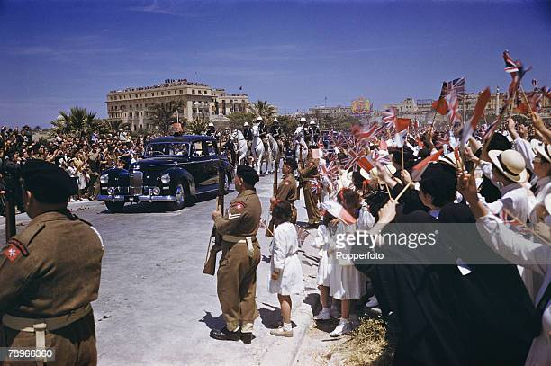 1954 Royal Tour to Malta Queen Elizabeth II and Prince Philip the Duke of Edinburgh are pictured in a Land Rover acknowledging the cheers of Maltese...