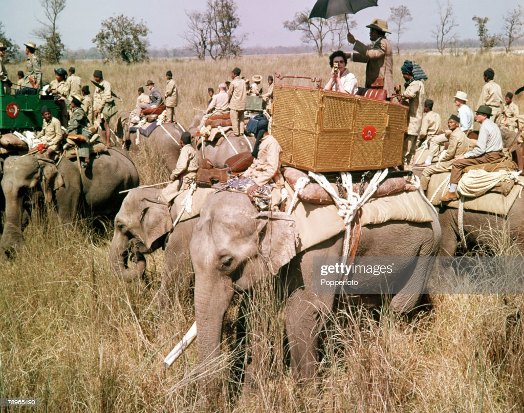 1961. Royal Tour to Nepal. A general scene during a Tiger hunt which Queen Elizabeth II (seated on nearest elephant with cinecamera) attended. : News Photo