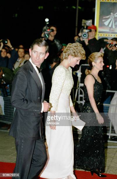 Royal Variety Performance Dominion Theatre London Monday 7th December 1992 Arrival of Prince Charles Princess Diana wearing pinktinged anklelength...