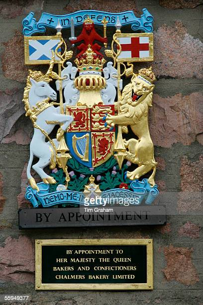 Royal Warrant Holder shield in front of Chalmers Bakery Bakers and Confectioners for Queen Elizabeth IIScotland UK