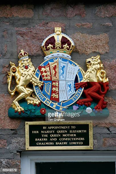 Royal Warrant Holder shield in front of Chalmers Bakery Bakers and Confectioners for Queen Elizabeth the Queen Mother in Scotland
