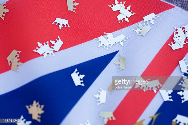 royal wedding confetti on union jack flag - royal stock photos and pictures