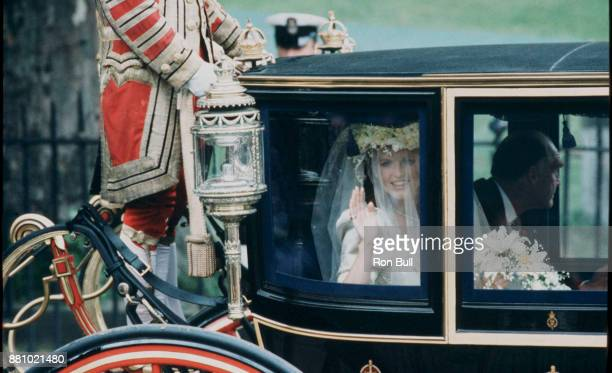 Royal Wedding Sarah Ferguson Published 19860724 with caption On her way Bridetobe Sarah Ferguson waves behind her wedding veil from the Glass Coach...