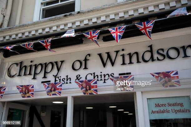 Royal Weddingthemed bunting hangs outside a fish and chip shop ahead of the wedding of Prince Harry and his fiance US actress Meghan Markle on May 10...