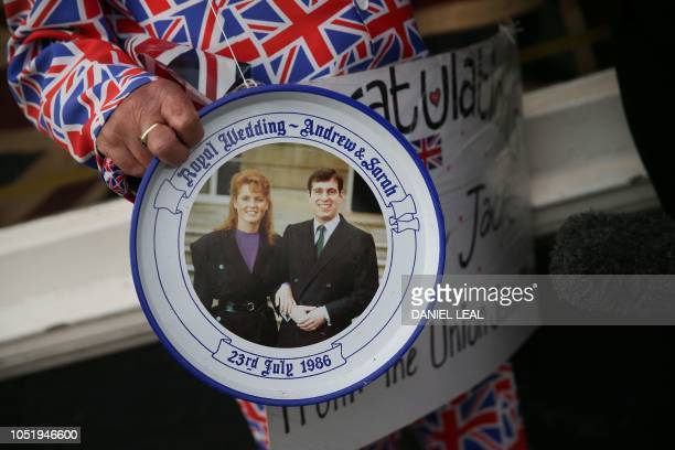Royal wellwisher Terry Hutt holds a plate from the 1986 wedding of Britain's Prince Andrew Duke of York and Sarah Ferguson Princess Eugenie's parents...