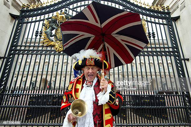 Royal wellwisher Tony Appleton poses outside Buckingham Palace in a traditional town crier outfit on September 9 2015 in London England Today Her...