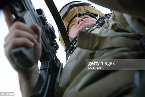 Royal Welsh Fusilier keeps watch from the hatch of a Land Rover during a patrol on the road from the southern Iraqi port of Umm Qasr to the city of...