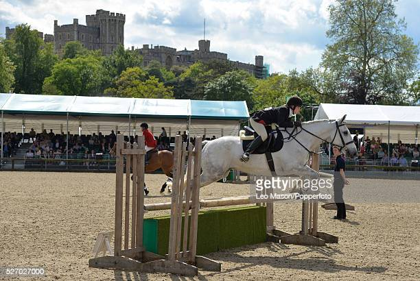 Royal Windsor Horse Show inside the private grounds of Windsor Castle UK Inter Hunt team Knock out with Windsor Castle in the background