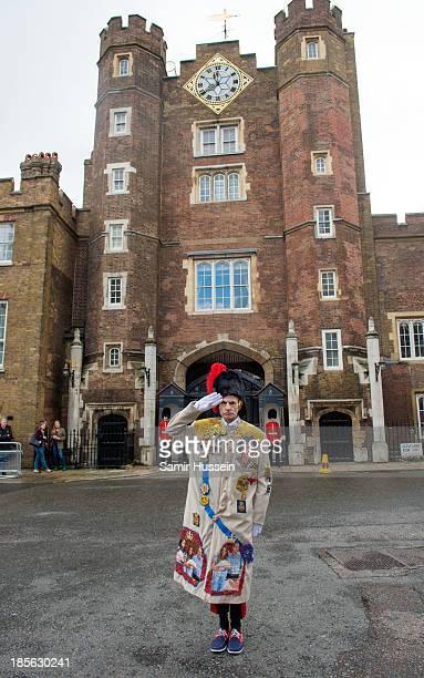 A royalist poses outside St James' Palace ahead of the christening of HRH Prince George of Cambridge on October 23 2013 in London England