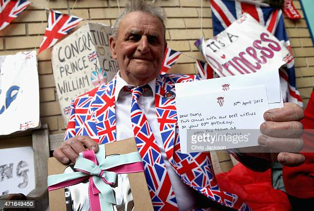 Royalist Terry Hutt poses with a cake and card he recieved from Kensington Palace on his 80th Birthday as he continues his wait for a new Royal baby...