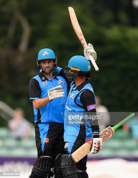 Royals batsman Callum Ferguson celebrates his 150 with Brett D'Oliveira during the Royal London One Day Cup match between Worcestershire and...