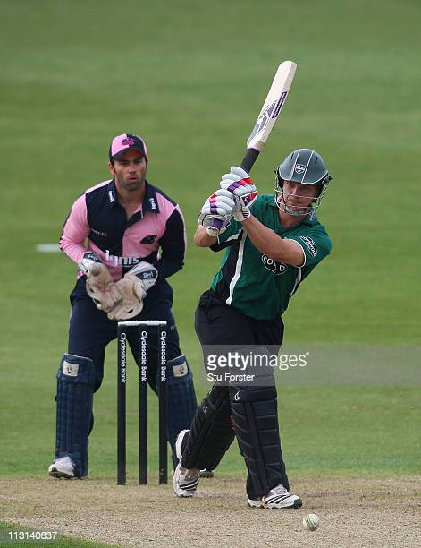 Royals batsman Gareth Andrew and his mongoose bat hit out watched by wicketkeeper Ben Scott during the Clydesdale Bank 40 match between...