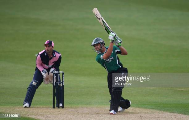 Royals batsman Vikram Solanki hits a boundary watched by wicketkeeper Ben Scott during the Clydesdale Bank 40 match between Worcestershire Royals and...