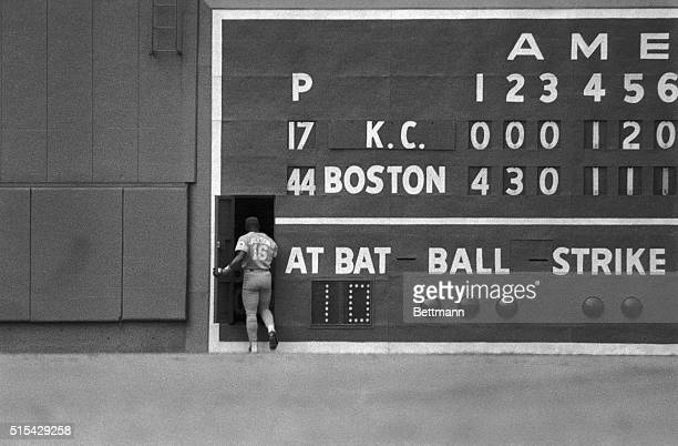 Royal's left fielder Bo Jackson takes refuge from the near 110degree heat and the Red Sox by ducking behind the scoreboard on Fenway Park's Green...