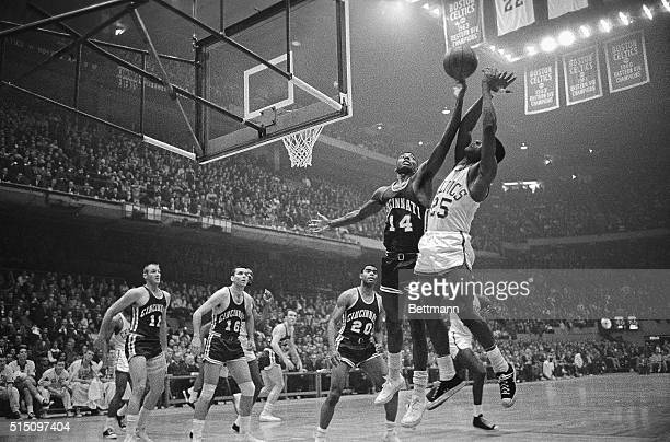 Royals' Oscar Robertson ticks the ball away from Celtics' K.C. Jones during the second quarter action, Eastern Division, NBA Playoffs, Boston Garden,...