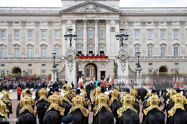 Royals stand on the balcony of Buckingham Palace as soldiers march past Queen Elizabeth II for Trooping The Colour celebrations on June 14 2008 in...