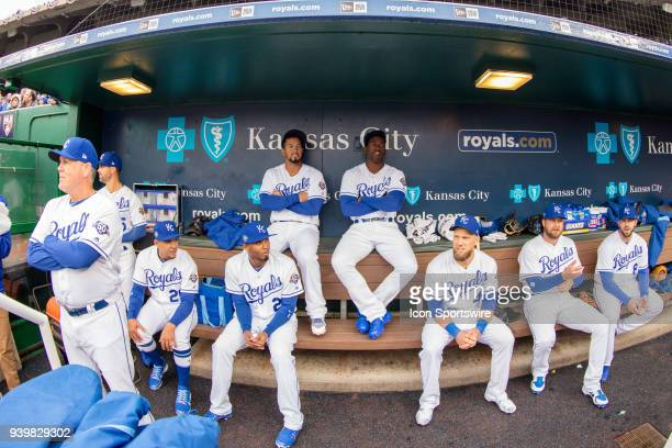 Royals starting lineup sits in the dugout prior to the major league opening day game between the Kansas City Royals and the Chicago White Sox on...