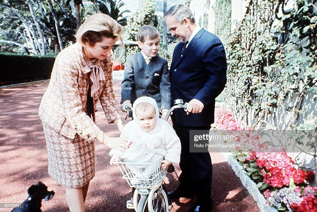 Royalty, 1964 Prince Rainier of Monaco with his wife Princess Grace and their two children Stephanie (on bicycle) and Albert