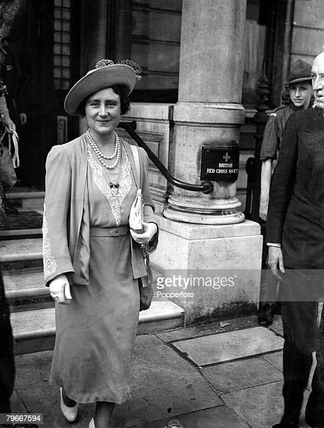 5th September 1939 Queen Elizabeth carrying her gasmask slung from her shoulder as she left after her visit to the British Red Cross