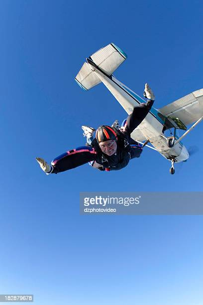 Royalty Free Stock Photo: Skydiver And a Cessna 182 Airplane