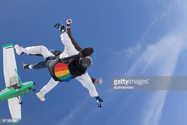 Royalty Free Stock Photo: Tandem Skydivers and the Airplane
