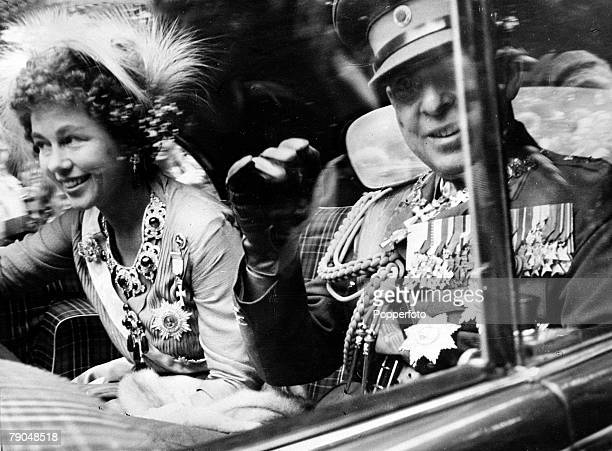 Circa 1940's, Queen Friederika, born 1917, waving to the crowd alongside her husband King Paul, , The couple married in 1938
