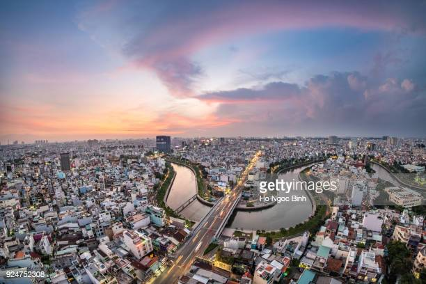royalty high quality free stock image aerial view of ho chi minh city, vietnam. beauty skyscrapers along river light smooth down urban development in ho chi minh city, vietnam. - ho chi minhstad stockfoto's en -beelden