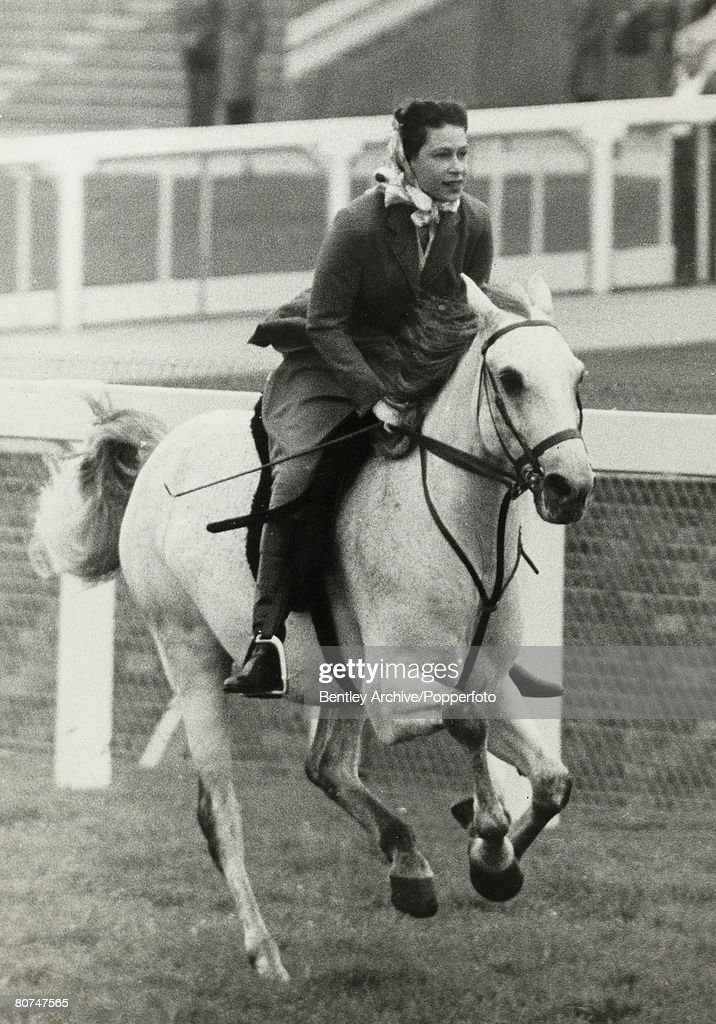 Royalty Horse Racing. Royal Ascot. 16th June 1961. HRH Queen Elizabeth II cantering up to the start of a 5 furlong outing with other members of the royal party. : News Photo