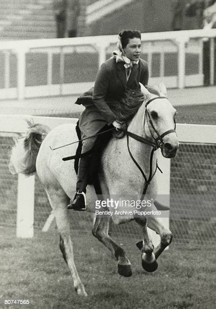 Royalty, Horse Racing, Royal Ascot, 16th June 1961, HRH Queen Elizabeth II cantering up to the start of a 5 furlong outing with other members of the...