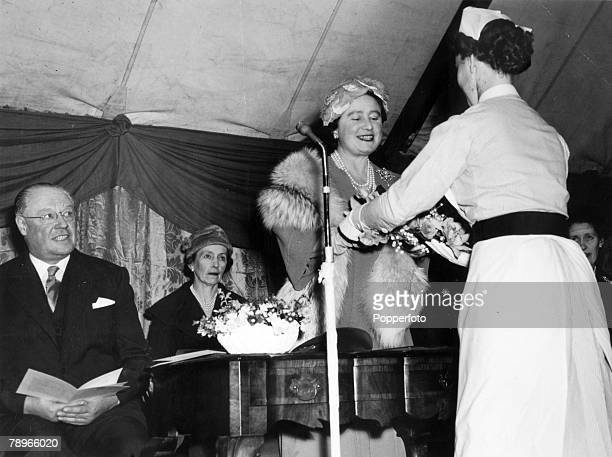 25th October 1956 Northampton Northamptonshire England HM Queen Elizabeth the Queen Mother receives a bouquet while on a visit to Northampton General...