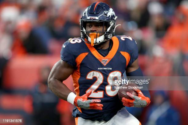 Royce Freeman of the Denver Broncos carries the ball against the Los Angeles Chargers in the third quarter at Empower Field at Mile High on December...
