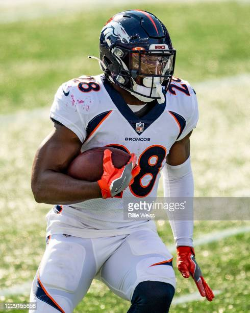 Royce Freeman of the Denver Broncos carries the ball during the first half of a game against the New England Patriots at Gillette Stadium on October...