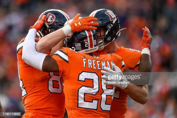 Royce Freeman of the Denver Broncos is congratulated after a second quarter touchdown against the Detroit Lions at Empower Field on December 22, 2019...