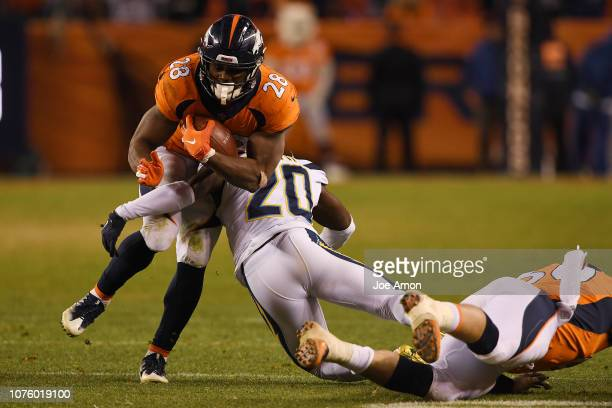 Royce Freeman of the Denver Broncos is tackled by Desmond King of the Los Angeles Chargers during the fourth quarter The Denver Broncos lost to the...