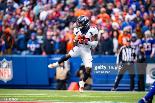 Royce Freeman of the Denver Broncos makes a pass reception during the third quarter against the Buffalo Bills at New Era Field on November 24, 2019...