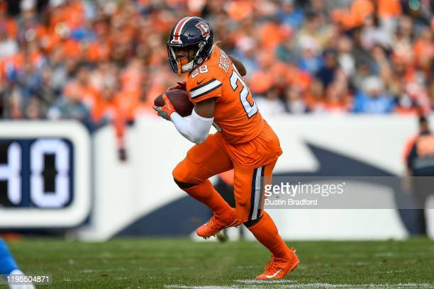 Royce Freeman of the Denver Broncos runs after a first quarter catch against the Detroit Lions at Empower Field on December 22, 2019 in Denver,...