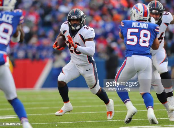 Royce Freeman of the Denver Broncos runs the ball during the second half against the Buffalo Bills at New Era Field on November 24, 2019 in Orchard...